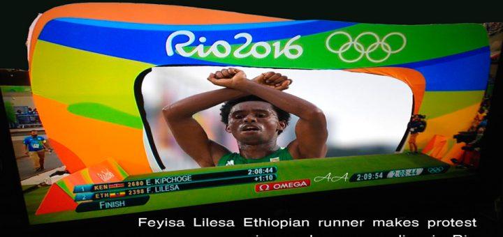 Feyisa Lilesa Ethiopian runner makes protest sign as he crosses line in Rio